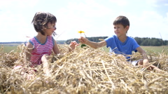 Girl enjoys the flower which gave her boy Stock Footage