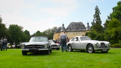 Aston Martin DB2 and Mercedes-Benz 280 SL classic sports cars Stock Footage