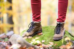 Close up of legs of unrecognizable woman in autumn nature Stock Photos