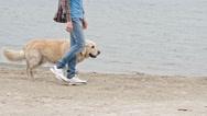 Walking Along Coast with Dog Stock Footage