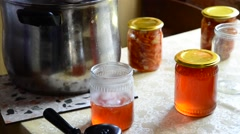 Housewife pours homemade jam in jar Stock Footage