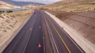 Aerial shot vehicles drive through a construction zone Stock Footage