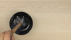 Smoking a cigar, to shake off the ashes, put a cigar in an ashtray Stock Footage