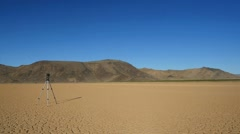 A photographer taking landscape shots in the desert Stock Footage