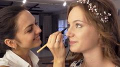Makeup artist doing makeup Stock Footage