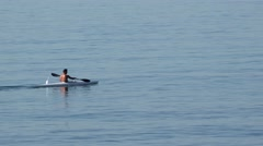 Kayak canoe rowing with paddles on the blue sea Arkistovideo