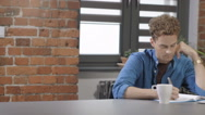 Young student studying at modern loft. Stock Footage