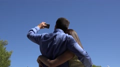 Couple of lover hugging take picture at airplane passing over blue sky Stock Footage