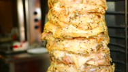 Greek gyros meat turns and roasting in an oven Stock Footage