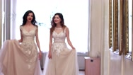 Girlfriends in long dresses with lace, walk vintage through the corridors Stock Footage