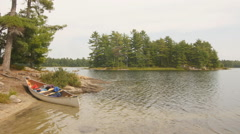 Canoe with paddle and camping equipment. Ontario, Canada. Stock Footage