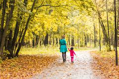 Mother with her baby. Mom and daughter in an autumn park Kuvituskuvat