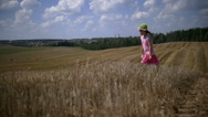Funny girl walking in the field at the top Stock Footage