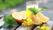 Juicy ripe oranges and orange juice Stock Footage