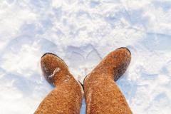 Russian traditional winter footwear - valenki. Winter sunny day, top view on  Stock Photos