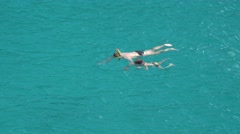 Father and child swimming and snorkeling in turquoise sea water Arkistovideo