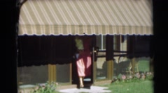 1954: cute baby running away from his mother in post-war suburban yard. Stock Footage