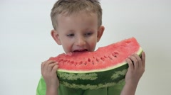 Portrait of loving child biting tasty red watermelon big slice, healthy food Stock Footage