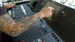 Hand adjusting audio mixer Stock Footage