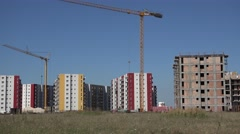 New constructions, block of flats and cranes, focus out Stock Footage