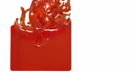 Juice. orange liquid fills up a container Stock Footage