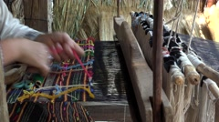 Woman hands working at wooden weaving machine, traditional art Stock Footage