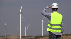Engineer near wind turbines making a phone call Stock Footage