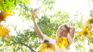 Beautiful girl making selfie among sunflowers. Stock Footage