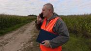 Farmer talking on smart phone at the corn field Stock Footage