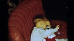 1954: a small boy in a chair opening a christmas present PENNINGTON, NEW JERSEY Stock Footage