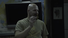 Bald man in a T-shirt with a skull says. The bearded guy with a pirate on the Stock Footage