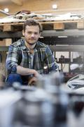 Portrait confident mechanic in auto repair shop Stock Photos