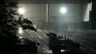 Stormy rain falling over construction site. Heavy rain falling at night Stock Footage