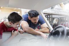 Father and son rebuilding classic car Stock Photos