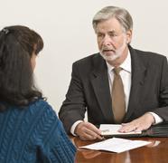 Business Professional Advises Client Stock Photos