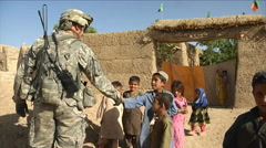 Soldiers on patrol in Zabul Province Afghanistan, shake hands with villagers and Stock Footage