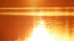 Golden sunrise lake surface. Eagle Lake, Ontario, Canada. Stock Footage