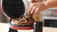 Pouring waffle batter onto a waffle iron Stock Footage