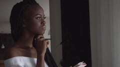 Close up portrait of a charming african female fashion model typing something on Stock Footage