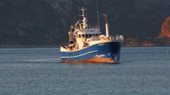 Fishing trawler in the fjord in North sea Stock Footage