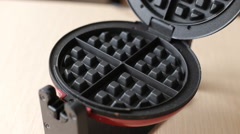 Girl Preparing Belgian Waffles in a Special Waffle Iron. the Action in Real Time Stock Footage