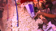 Selling popcorn on the street. Buying a popcorn on the street Stock Footage