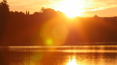 Sunrise over golden lake with trees. Eagle Lake, Ontario, Canada. Stock Footage