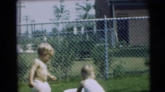 1954: two children playing in a gardens PENNINGTON, NEW JERSEY Stock Footage