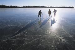 Ice skating on Lake Superior near Thunder Bay, Ontario, Canada. Stock Photos