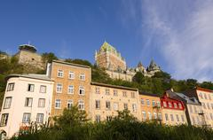 View up from Vieux-Port to Chateau Frontenac with classic buildings on rue du Stock Photos
