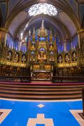Interior alter of Notre-Basilica, at Place d'Armes in Old Montreal, Quebec, Stock Photos