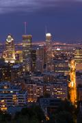 Skyline view at twilight from the lookout atop Mt. Royal, Montreal, Quebec, Stock Photos