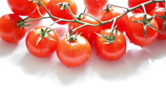 Red cherry tomatoes on white background Stock Footage