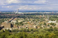 Olympic Stadium and neighborhoods of east Montreal, Quebec, Canada. Stock Photos